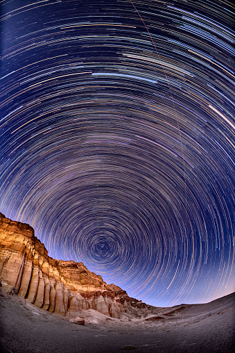 Star trails over mountains - gettyimageskorea