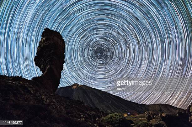 star trails over of teide volcano and los roques de garcia rocks, teide national park, tenerife, canary islands, spain. - active volcano stock pictures, royalty-free photos & images