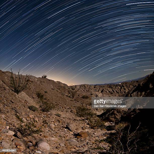 star trails over one of the many rugged canyons in the santa rosa mountains. anza borrego desert state park, california. - country geographic area stock pictures, royalty-free photos & images
