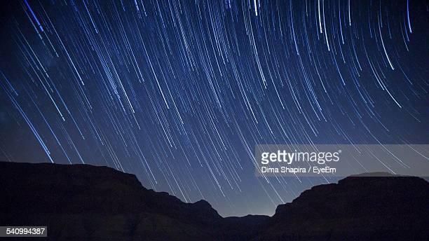 Star Trails Over Silhouette Mountains At Night