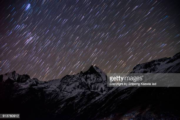 Star trails over the Machhapuchhre peak from the Annapurna Base Camp (ABC), Nepal.