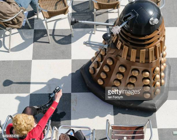 Star Trek character fires her ray-gun at a Dalek during the Scarborough Sci-Fi event held at the seafront Spa Complex on April 21, 2018 in...