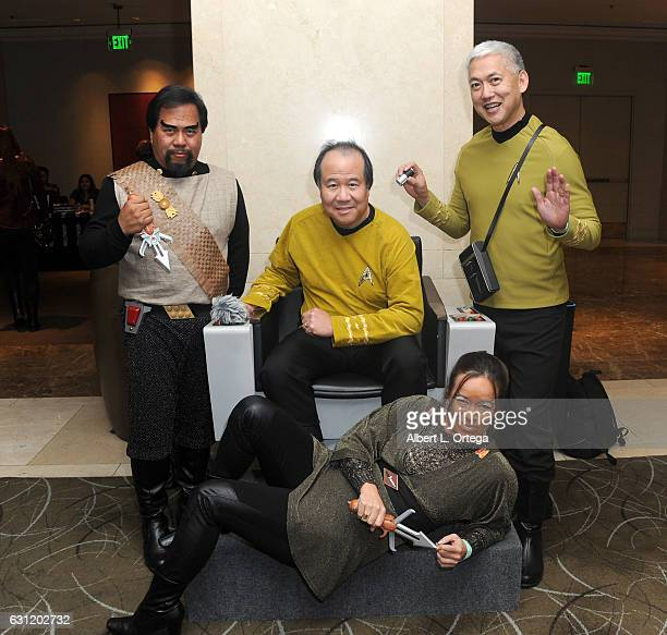 Star Trek cosplayers Bill Arucan David Cheng Mark Lum and Michelle Wells pose with the Captain's Chair provided by The Hollywood SciFi Museum at The...
