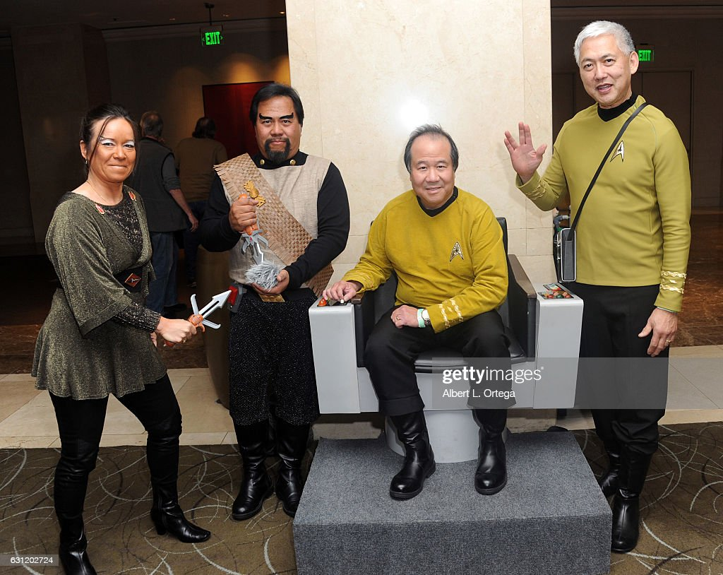 Star Trek cosplayers Michelle Wells, Bill Arucan, David Cheng and Mark Lum pose with the Captain's Chair provided by The Hollywood Sci-Fi Museum at The Hollywood Show held at The Westin Los Angeles Airport on January 7, 2017 in Los Angeles, California.
