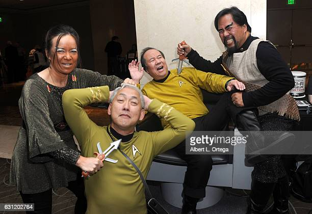 Star Trek cosplayers Michelle Wells Mark Lum David Cheng and Bill Arucan pose with the Captain's Chair provided by The Hollywood SciFi Museum at The...