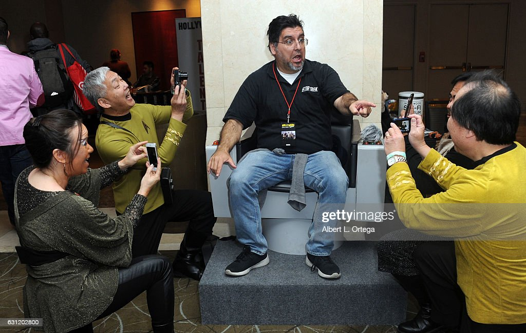 Star Trek cosplayers Michelle Wells, Mark Lum, David Cheng and Bill Arucan pose with the Captain's Chair provided by The Hollywood Sci-Fi Museum at The Hollywood Show held at The Westin Los Angeles Airport on January 7, 2017 in Los Angeles, California.