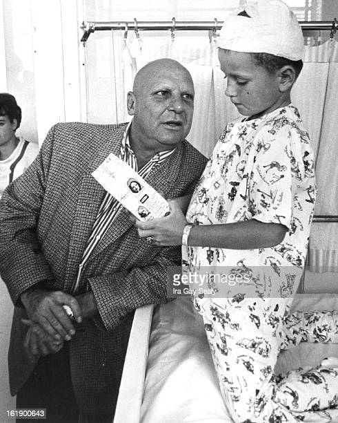 Star Visits Denver Jackie Coogan who plays Uncle Fester on TV's The Addams Family gives an Uncle Fester doll to one of his fans Don Sickels son of Mr...