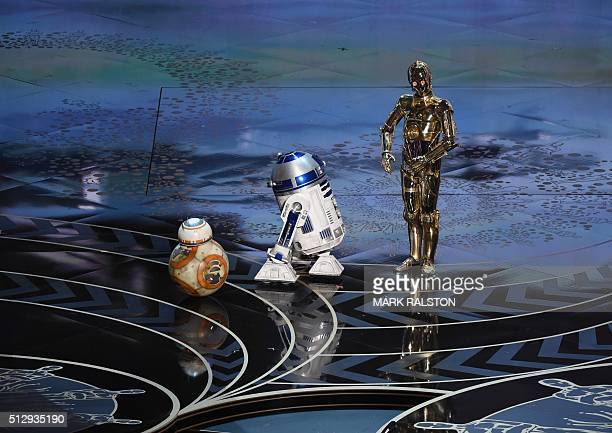 Star Wars C-3PO R2D2 and BB-8 arrive on stage at the 88th Oscars on February 28, 2016 in Hollywood, California. AFP PHOTO / MARK RALSTON / AFP / MARK...