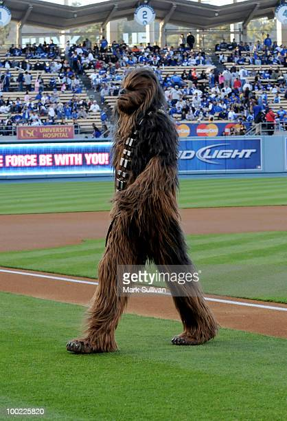 Star Wars character Chewbacca leaves the field after throwing out the ceremonial first pitch to celebrate the 30th anniversary of 'The Empire Strikes...