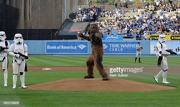 Star Wars character Chewbacca with Stormtroopers throws out the ceremonial first pitch to celebrate the 30th anniversary of 'The Empire Strikes Back'...