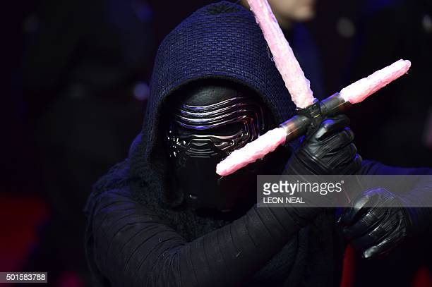 """Star wars character Kylo Ren poses on arrival for the European Premiere of """"Star Wars: The Force Awakens"""" in central London on December 16, 2015...."""