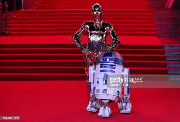 Star Wars characters C3PO and R2D2 pose on the red carpet for the European Premiere of Star Wars The Last Jedi at the Royal Albert Hall in London on...