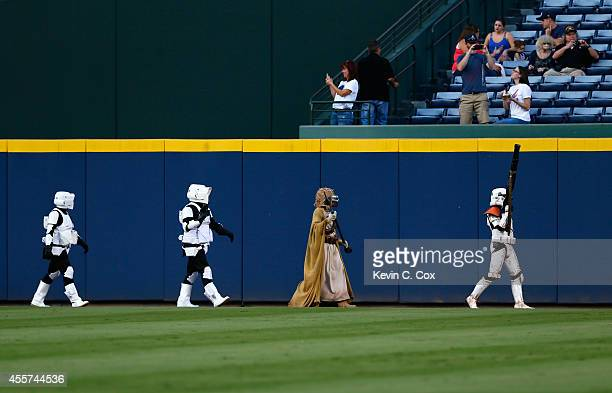 Star Wars characters from the 501st Legion walk around the field prior to the game between the Atlanta Braves and the New York Mets at Turner Field...