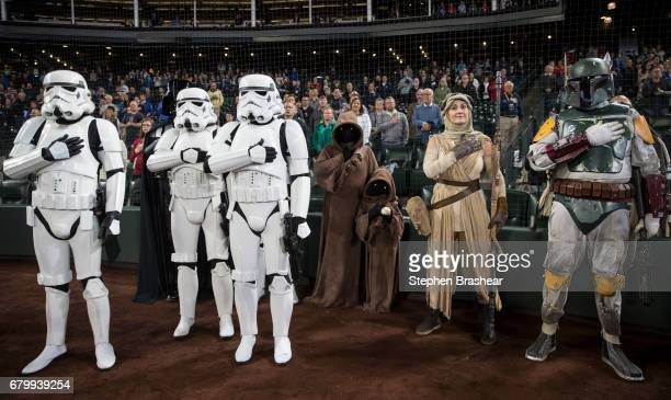 Star Wars characters including stormtroopers jawas Rey and Boba Fett stand during the singin of the Star Spangled Banner before game between the Los...