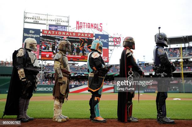 Star Wars characters line up for the national anthem before the game between the Washington Nationals and the Philadelphia Phillies on Star Wars Day...