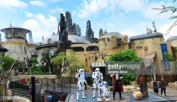 Star Wars characters R2-D2, Hondo Ohnaka, BB-2, Chewbacca and Storm Troppers perform during the Star Wars: Galaxy's Edge Dedication Ceremony at...