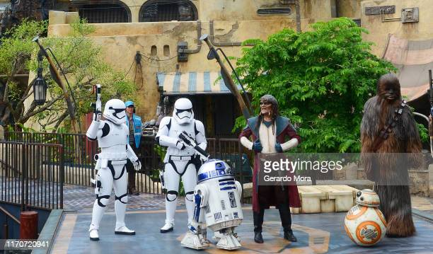 Star Wars characters R2-D2, Hondo Ohnaka, Chewbacca and Storm Troppers perform during the Star Wars: Galaxy's Edge Dedication Ceremony at Disney's...