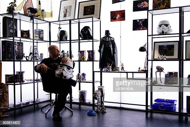 Star Wars collector Daryll Jones poses with a selection of his collection during an event in east London on January 20 to promote storage solutions...