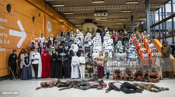 Star Wars cosplayers from the British Garrison of the 501st Legion costuming group pose for a large group photograph with other cosplayers including...