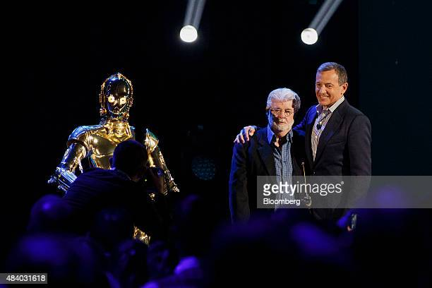 Star Wars director George Lucas left and Robert 'Bob' Iger chief executive officer of The Walt Disney Co stand for a photograph during the Disney...