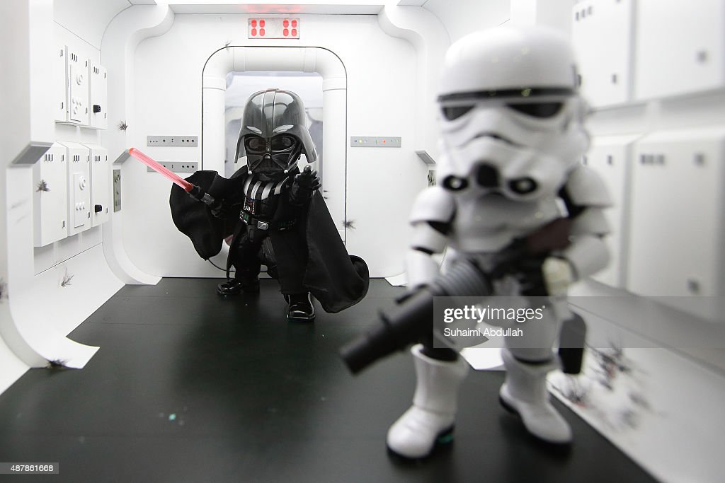 A Star Wars Episode V Stormtrooper and Darth Vader collectible figures on display during the Singapore Toy, Game & Comic Convention at the Sands Expo & Convention Centre on September 12, 2015 in Singapore. The Singapore Toy, Game & Comic Convention (STGCC) shows off the worlds of toys, games, comics, anime, manga and collectibles.