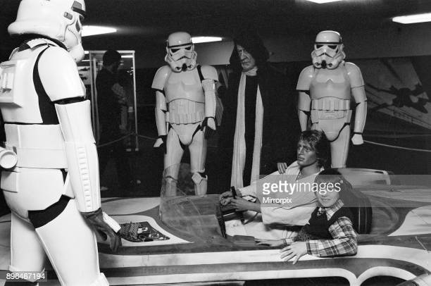 Star Wars Exhibition on display at the Science Museum London 19th December 1977 Stormtroopers ObiWan Kenobi Luke Skywalker and his hovercraft the X34...