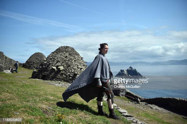 Star Wars fan and cosplayer Sharon Zonneveld dressed as the character Rey poses for a photograph as she attempts to replicate poses and scenes from...
