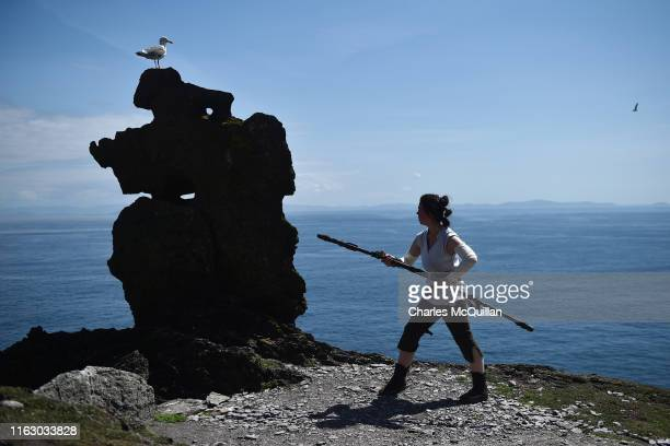 Star Wars fan and cosplayer Sharon Zonneveld dressed as the character Rey poses for a photograph at the Wailing Woman rock as she attempts to...