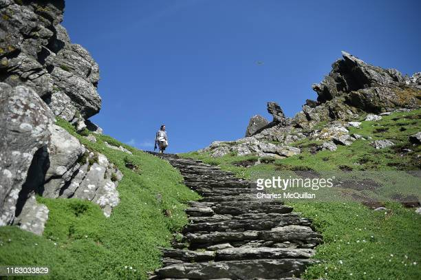 Star Wars fan and cosplayer Sharon Zonneveld dressed as the character Rey pictured as she walks along a narrow path on Skellig Michael on August 21...