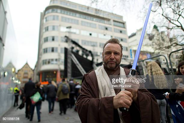 Star Wars fan dressed as Obi Wan Kenobi poses for photographs in Leicester Square ahead of the European premiere of Star Wars The Force Awakens on...