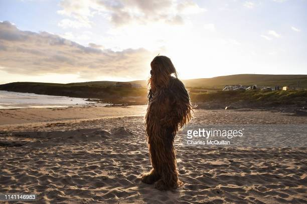 Star Wars fan dressed as the character Chewbacca looks out towards Skellig Michael island on May 4 2019 in Portmagee Ireland The latest Star Wars...