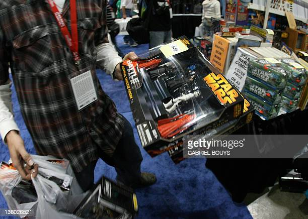 """Star Wars fan shops souvenirs during the opening day of """"Star Wars Celebration IV"""" in Los Angeles, 24 May 2007. The five-day convention celebrates..."""
