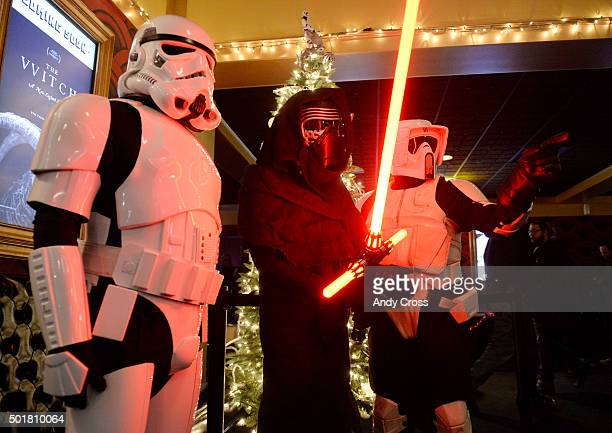Star Wars fan Tyler Comst center dressed up as Star Wars character Kylo Ren gets his picture taken by friend in between two Star Wars Stormtroopers...