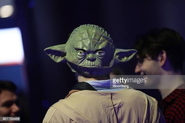 A Star Wars fan wears a Yoda mask ahead of the first public screening of Walt Disney Co's Star Wars The Force Awakens at a Vue Entertainment Ltd...