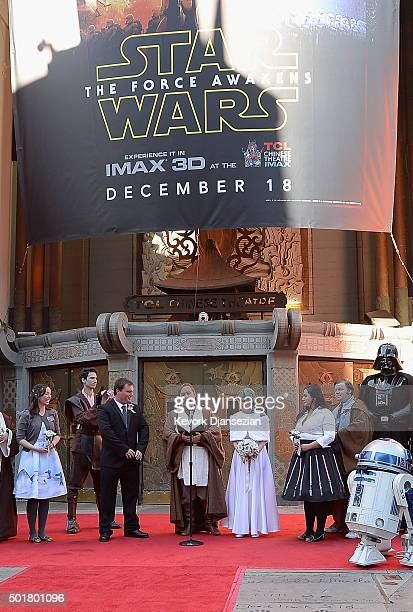 Star Wars fans Andrew Porters and Caroline Ritter of Australia are married in a Star Warsthemed wedding in the forecourt of TCL Chinese Theatre IMAX...