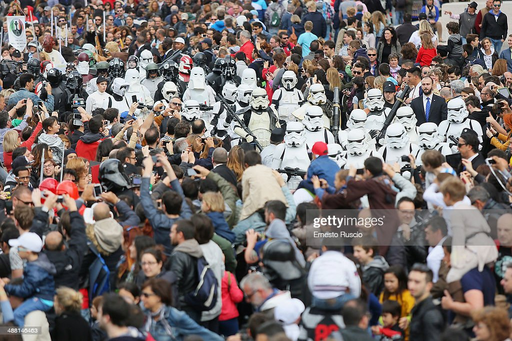 Star Wars fans dressed as Stormtroopers walk through the crowd during the Star Wars Day 2014 at Colloseo on May 4, 2014 in Rome, Italy.