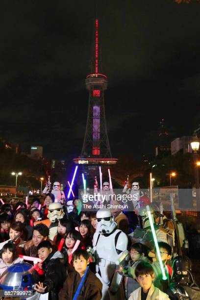 Star Wars fans gather under the Television Tower which turned into a 180metretall lightsaber ahead of the opening of the 'Star Wars The Last Jedi' on...