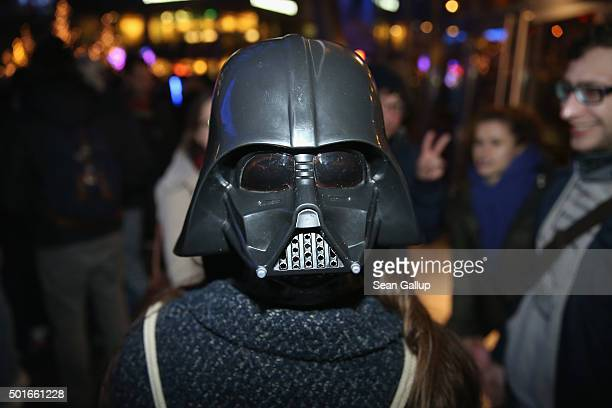 Star Wars fans including one wearing a Darth Vader mask on the back of her head arrive for a midnight plus one minute first regular screening of Star...