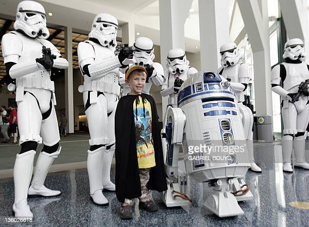 """Star Wars fans pose during the """"Star Wars Celebration IV"""" in Los Angeles, 25 May 2007. The five-day convention celebrates the 30th anniversary of the..."""