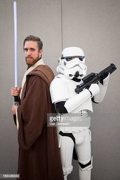 Star Wars fans pose for the camera at the London Film And Comic Con at Olympia Exhibition Centre on October 6 2013 in London England The event which...
