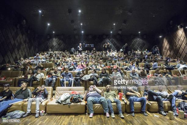 Star Wars fans watch the latest of the Star Wars film series Star Wars The Last Jedi movie in Istanbul Turkey on December 13 2017 Event including...