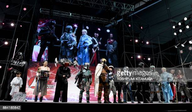 Star Wars fans wearing various costumes from the films are pictured during the Star Wars Cosplay Showcase 2017, part of Tokyo Comic Con 2017 at...