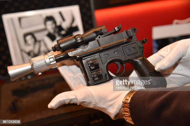 Star Wars' Han Solo's BlasTech DL-44 blaster is exhibited by Julien's Auctions at Planet Hollywood, in New York, on May 21, 2018. - The auction will...