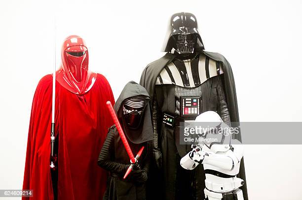 Star Wars Imperial family of cosplayer dressed as an Emperors Royal Guardsmen Kylo Ren Darth Vader and a Stormtrooper on day 2 of the November...