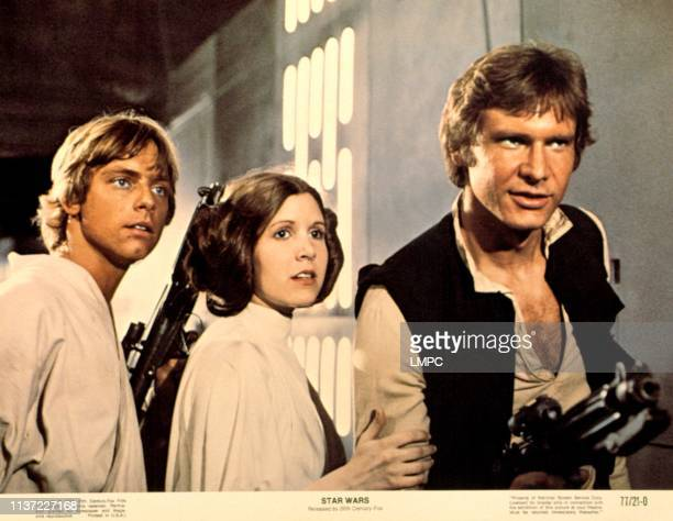 EPISODE IV A NEW HOPE Mark Hamill Carrie Fisher Harrison Ford 1977