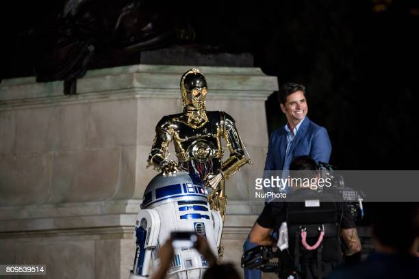 Star Wars' R2D2 and C3PO and Emmy Awardnominated actor producer and host John Stamos rehearsed for the 37th annual A Capitol Fourth a celebration for...