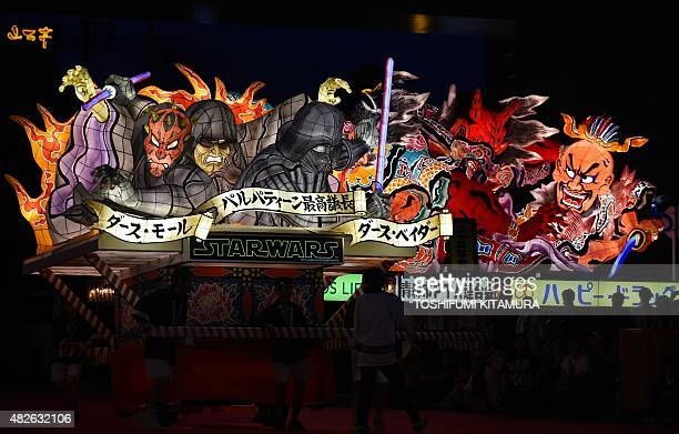 Star Wars Sith Nebuta float featuring Darth Maul, Sheev Palpatine and Darth Vader moves beside traditional Nebuta float during the eve of the Nebuta...