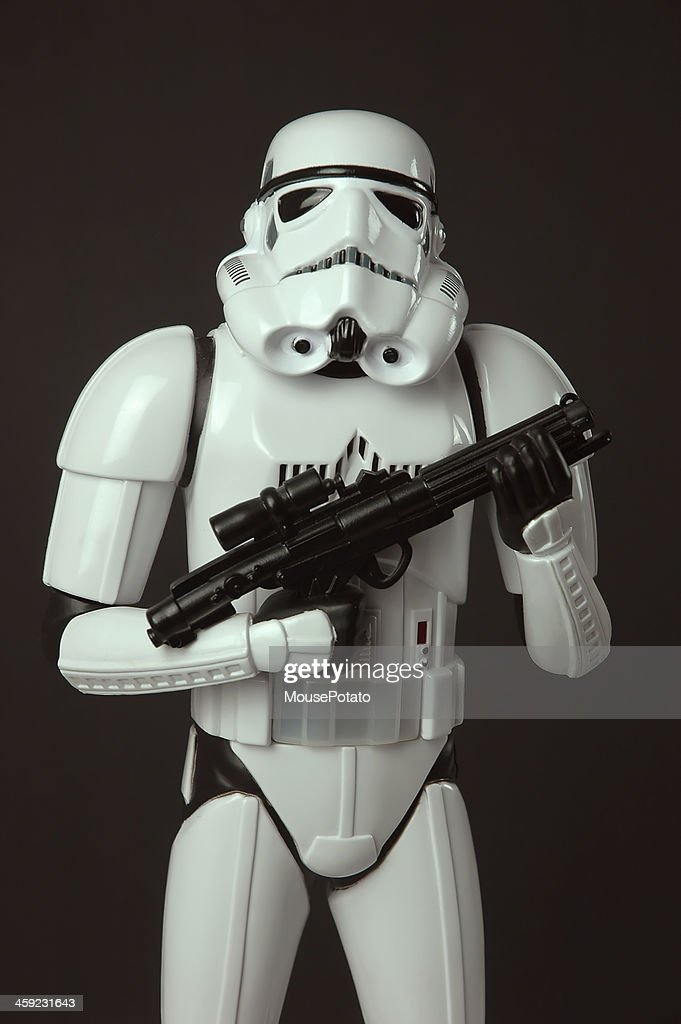 Star Wars Stormtrooper toy figure standing with blaster weapon : Stock Photo