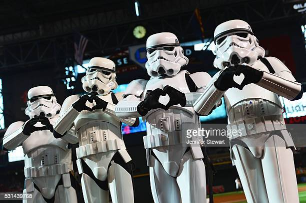 Star Wars Stormtroopers make 'hand hearts' for a photo prior to the MLB game between the San Francisco Giants and the Arizona Diamondbacks at Chase...