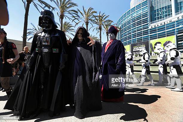 Star Wars villain Darth Vader leads a parade of Star Wars characters from the worldwide 501st Legion costume organization at the Star Wars...